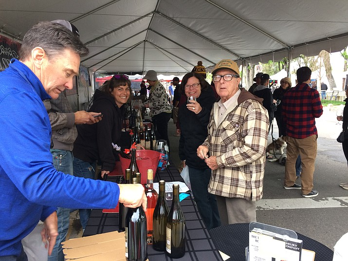 Prescott residents Sally and Ron Sutterfield, at right, enjoy a glass of wine at the Pillsbury Wine Company booth Saturday, May 11, during the Mother's Day Prescott Fine Art and Wine Festival on Cortez Street.