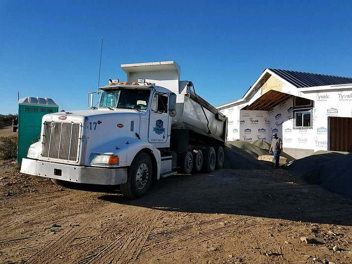 A BLA Trucking crew delivers pea gravel to a Prescott Valley Police Department Sergeant's new house. The company, as well as others, donated time and money to help the Sergeant with the construction project after he had a stroke. (Courtesy)
