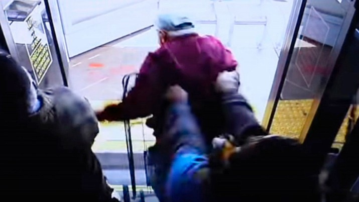 In this still image taken from security video and provided by the Las Vegas Metropolitan Police Department, a woman shoves a 74-year-old man off a public transit bus on March 21, 2019. The man, Serge Fournier, hit his head on the sidewalk and died a month later. The Clark County coroner ruled his death a homicide resulting from his injuries. Cadesha Michelle Bishop was arrested Monday, May 13, 2019, and is scheduled to appear in court on May 21. (Las Vegas Metropolitan Police Department via AP)