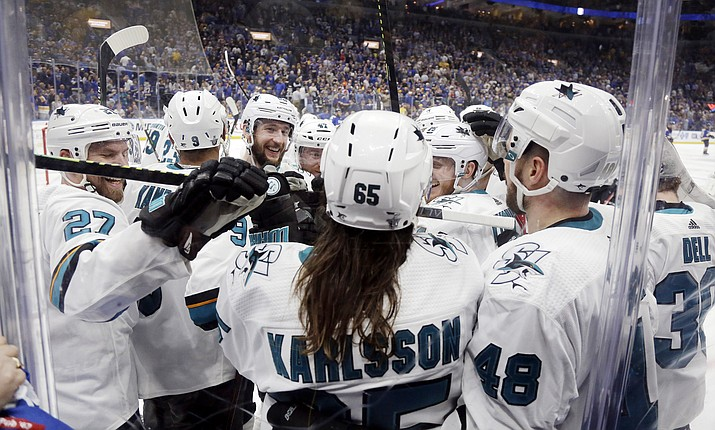 San Jose Sharks defenseman Erik Karlsson (65) is congratulated after scoring the winning goal against the St. Louis Blues during overtime in Game 3 of the NHL hockey Stanley Cup Western Conference final series Wednesday, May 15, 2019, in St. Louis. The Sharks won 5-4 to take a 2-1 lead in the series. (Jeff Roberson/AP)