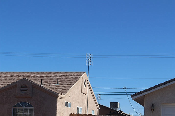 A TV antenna on the roof of a residential house in Kingman. (Photo by Agata Popeda/Daily Miner)