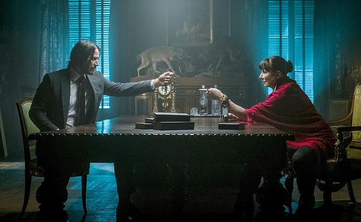"This image released by Lionsgate shows Keanu Reeves, left, and Anjelica Huston in a scene from ""John Wick: Chapter 3 - Parabellum."" (Niko Tavernise/Lionsgate via AP)"
