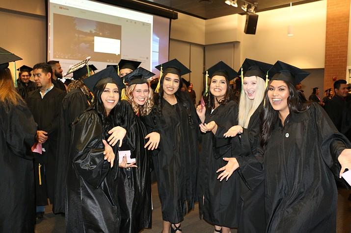 Yavapai College grads enjoying a photo opportunity. (Courtesy)