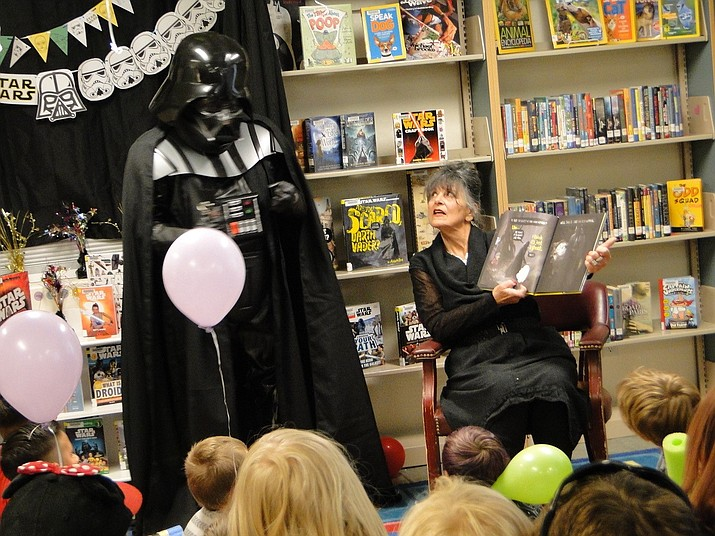 DarthVader and librarian Susan Lapis read an interactive story to children gathered May 4 at the Cordes Lakes Library. (Pat Williamson/Courtesy)