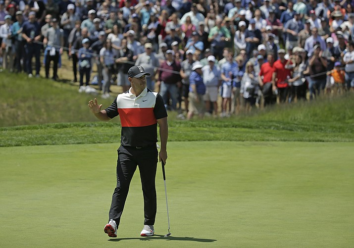 Brooks Koepka reacts after sinking a putt for birdie on the fifth green during the first round of the PGA Championship golf tournament, Thursday, May 16, 2019, at Bethpage Black in Farmingdale, N.Y. (Seth Wenig/AP)