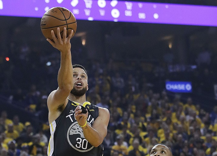 Golden State Warriors guard Stephen Curry (30) during the first half of Game 2 of the NBA playoffs Western Conference finals in Oakland, Calif., Thursday, May 16, 2019. (Jeff Chiu/AP)