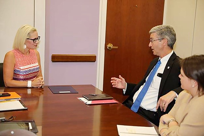Arizona senior Sen. Kyrsten Sinema meets with Dr. Barry Butler, President of Embry-Riddle Aeronautical University in Prescott. (Courtesy)