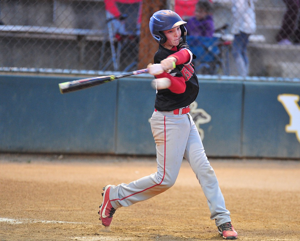 Adrian Sanderford singles as Farmers Insurance faced off against the True Value in the Prescott Little League Majors City Championship Game Friday, May 17.  (Les Stukenberg/Courier)