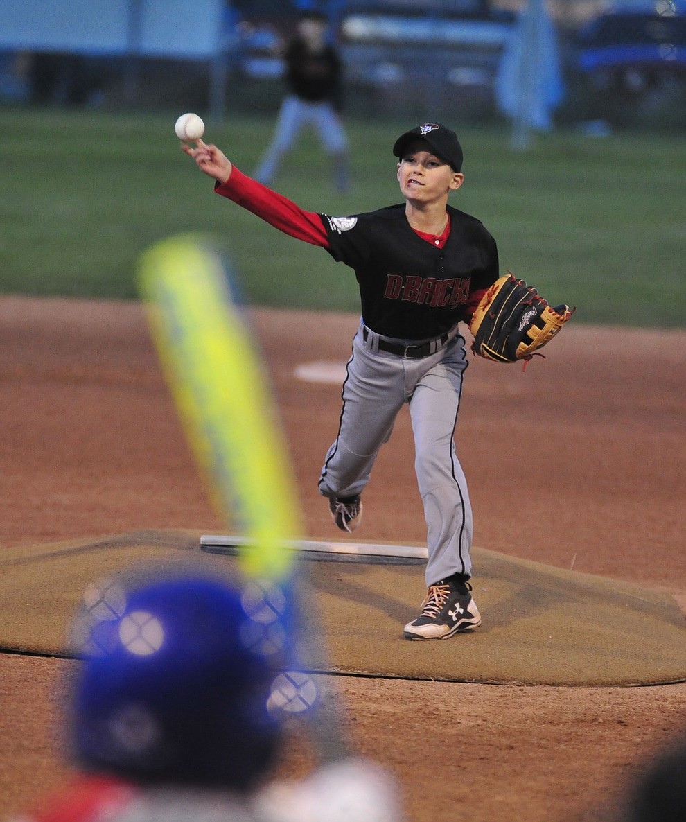 Caden Bernier pitches as Farmers Insurance faced off against the True Vaue in the Prescott Little League Majors City Championship Game Friday, May 17.  (Les Stukenberg/Courier)