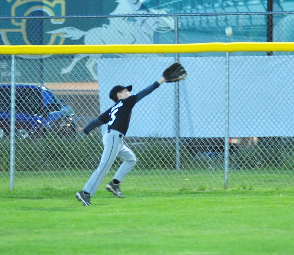 Ryan Crandall just misses a deep fly ball as Farmers Insurance faced off against the True Vaue in the Prescott Little League Majors City Championship Game Friday, May 17.  (Les Stukenberg/Courier)