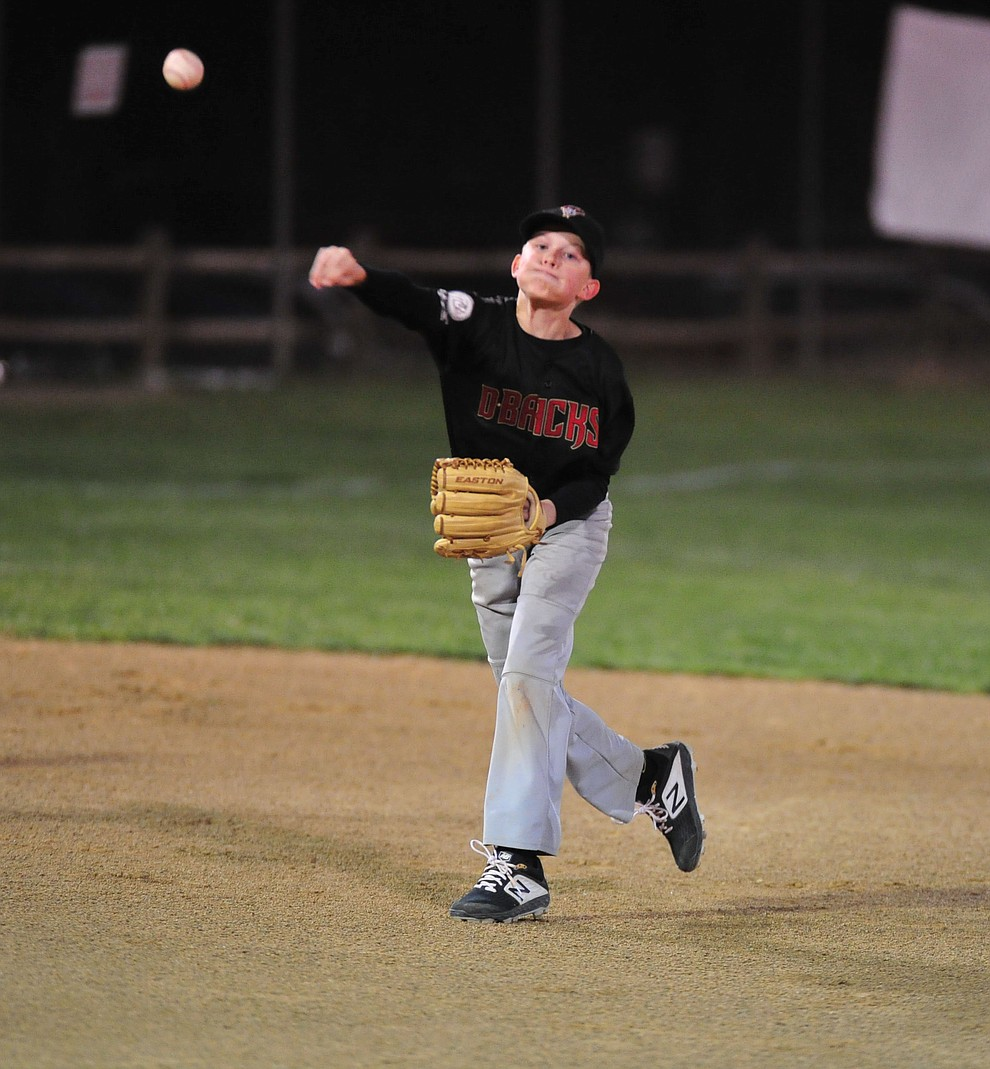 Tommy Richardson makes the throw from shortstop as Farmers Insurance faced off against the True Vaue in the Prescott Little League Majors City Championship Game Friday, May 17.  (Les Stukenberg/Courier)
