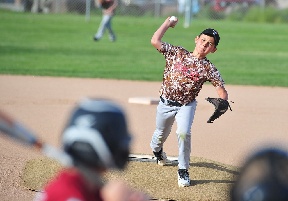 Romeo Plancencia delivers a pitch as the Grand Highland Cobras faced off against the Process Driven Baseball Diamondbacks in the Prescott Little League Minors City Championship Game Friday, May 17.  (Les Stukenberg/Courier)