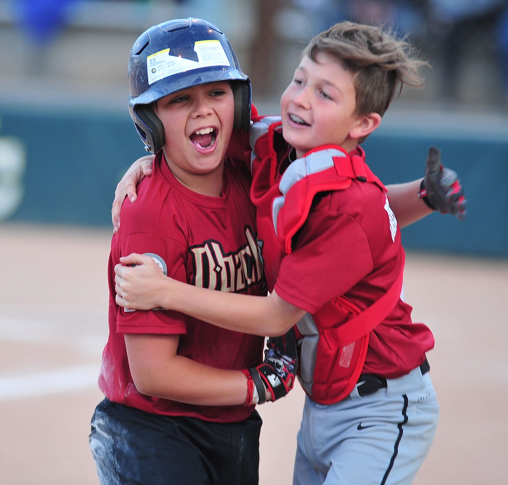 Quinton DelPrata and Dylon Patterson celebrate as the Grand Highland Cobras faced off against the Process Driven Baseball Diamondbacks in the Prescott Little League Minors City Championship Game Friday, May 17.  (Les Stukenberg/Courier)