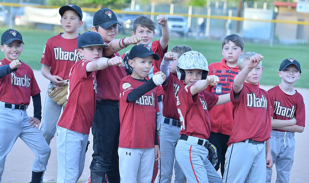Process Driven Baseball Diamondbacks show off their chmpionship rings after they defeated the Grand Highland Hotel Cobras in the Prescott Little League Minors City Championship Game Friday, May 17.  (Les Stukenberg/Courier)