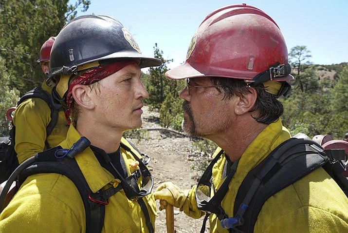 "Miles Teller (as Brendan McDonough), left, and Josh Brolin (as Eric Marsh) in a scene from the movie, ""Only the Brave."" (Sony Pictures)"