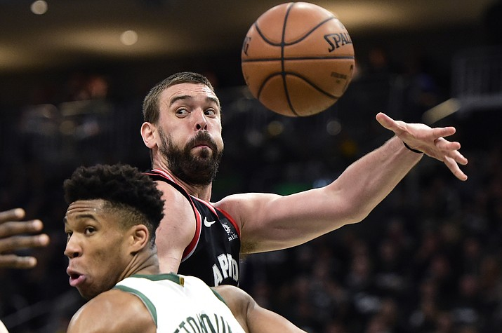 Toronto Raptors center Marc Gasol (33) throws a pass as Milwaukee Bucks forward Giannis Antetokounmpo (34) defends during the second half of Game 2 of the NBA playoffs Eastern Conference finals, Friday, May 17, 2019, in Milwaukee. (Frank Gunn/The Canadian Press via AP)