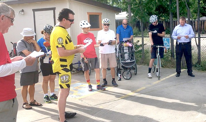 David Waechter reads the poem, Ride of Silence, at the Verde Valley Bike Shop in Cottonwood, on Thursday. VVN/Vyto Starinskas