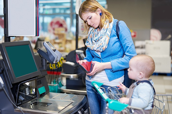Self-checkout, even with help, is not a thing of the past. (Adobe stock image)