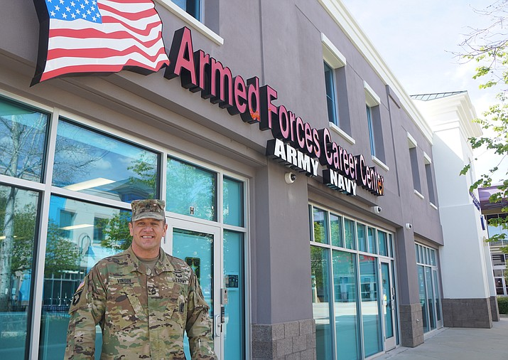 Matthew Vinson, U.S. Army Sgt. First Class and Station Commander of the local military recruiting center, stands in front of the center's new location in the Prescott Valley Entertainment District. Vinson said the station opted to move from its previous location at the Prescott Gateway Mall, in part, to be closer to a younger demographic. (Cindy Barks/Courier)