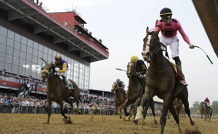 Tyler Gaffalione, right, rides War of Will to victory during the Preakness Stakes on Saturday at Pimlico Race Course. (AP Photo/Steve Helber)