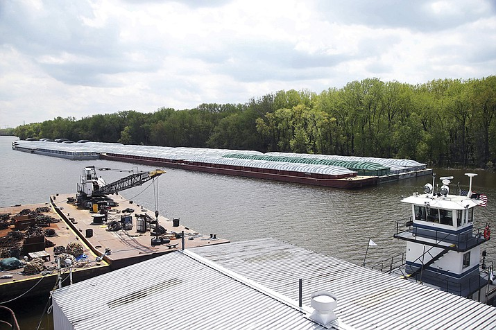Barges already loaded with soy beans, potash or scrap steel await movement on the Mississippi River in St. Paul, Minn., as spring flooding interrupts shipments on the river. Historic Midwest flooding that began in March has left parts of the Mississippi River closed for business. (Jim Mone/AP)
