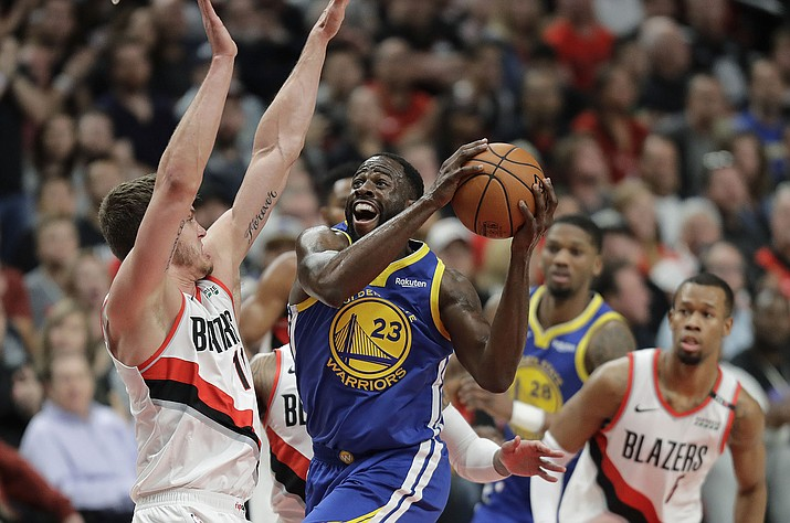 Golden State forward Draymond Green shoots against Portland's Meyers Leonard, left, during the first half of Game 3 of the Western Conference finals, Saturday, May 18, 2019, in Portland, Ore. (Ted S. Warren/AP)