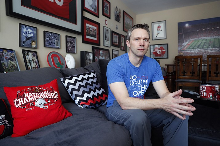 Brian Garrett poses for a photo at his home, Saturday, May 18, 2019, in Powell. Ohio. Former nursing student Brian Garrett said he worked for a short time at an off-campus clinic Dr. Richard Strauss opened after he was ousted at Ohio State in the late 1990s. But Garrett quit after witnessing abuse by Strauss and then experiencing it himself. (John Minchillo/AP)