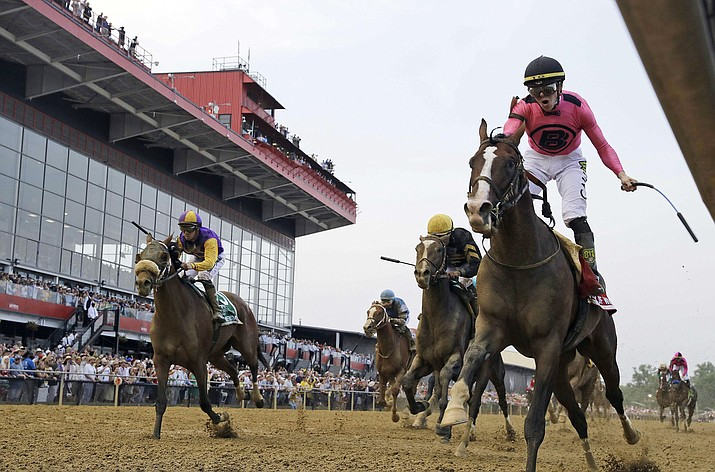 Jockey Tyler Gaffalione, right, reacts aboard War of Will, as they cross the finish to win the Preakness Stakes at Pimlico Race Course, Saturday, May 18, 2019, in Baltimore. (Steve Helber/AP)