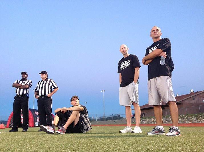 "From left, high school football officials Eric Sanders and Bill Fernow prepare to work Bradshaw Mountain's game against Kingman Sept. 25, 2014, at Bob Pavlich Field, as do longtime Bears ""chain gang"" members George Ponte (seated), Doug Beilfuss and Larry Haese. Ponte, a popular, longtime teacher at Bradshaw, has retired after suffering a stroke in March 2019. (Doug Cook/Courier file)"