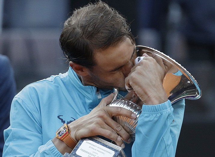 Rafael Nadal of Spain kisses his trophy after winning against Novak Djokovic of Serbia at the end of their final match at the Italian Open, in Rome, Sunday, May 19, 2019. (Gregorio Borgia/AP)