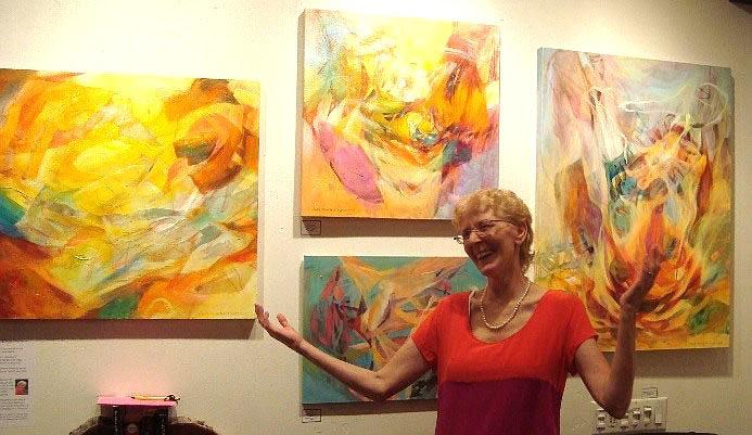 Julie Bernstein Engelmann with some of her luscious artwork. Photo by Amber Skye Engelmann.