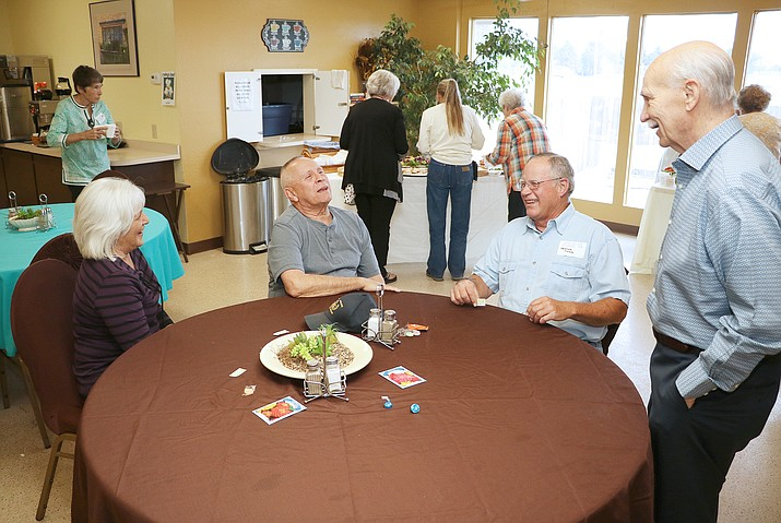 Mayor Darryl Croft, right, speaks with town volunteers at a volunteer reception held at the Chino Valley Senior Center on Thursday, May 2, 2019. About 16,000 hours were volunteered over the past year. (Matt Santos/Courtesy)