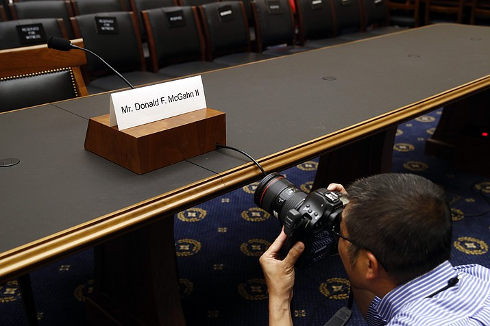 A photojournalist photographs a name placard for former White House Counsel Don McGahn, who is not expected to appear before a House Judiciary Committee hearing, Tuesday, May 21, 2019, on Capitol Hill in Washington. (Patrick Semansky/AP)