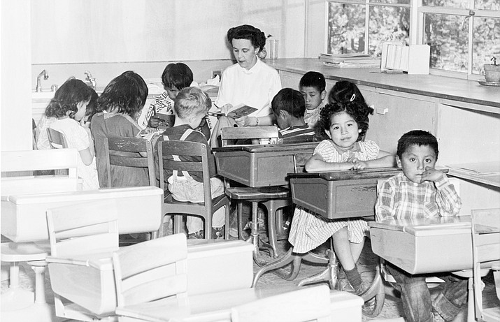Grand Canyon first grade students gather around Mrs. Guthrie for story time, circa 1953 at Grand Canyon School. (Photo/Grand Canyon National Park Museum Collection)