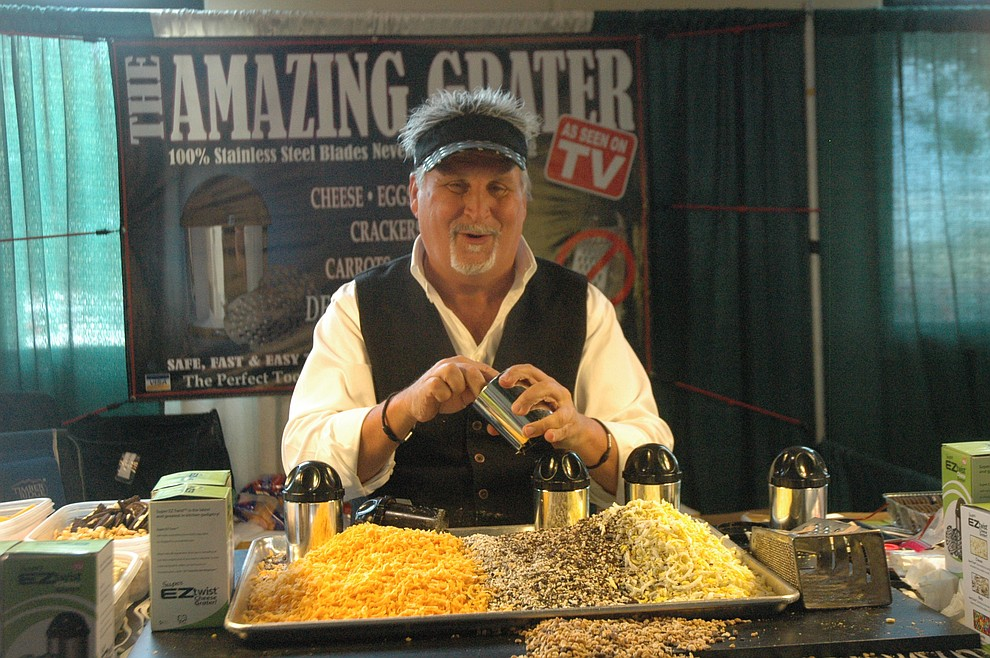 Clive Sinclair showing off The Amazing Grater at the YCCA Home & Garden Show Saturday, May 18 at the Findlay Toyota Center. The event continues through Sunday, May 19. (Jason Wheeler/Courier)