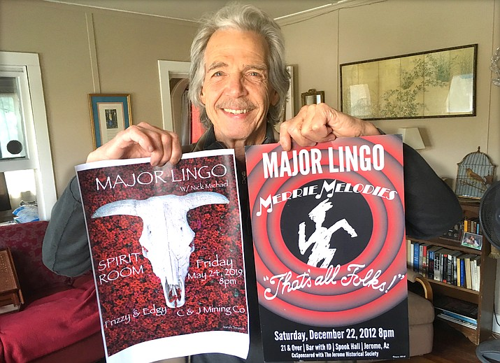 """John Ziegler holds up a poster for this Friday's Major Lingo reunion at the Spirit Room in Jerome, along with a poster for the band's """"final"""" show in 2012. VVN/Vyto Starinskas"""