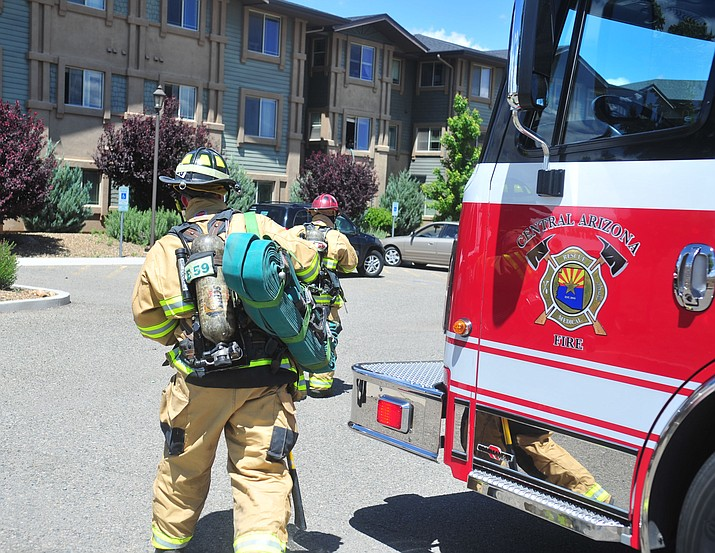 Central Arizona Fire and Medical Authority firefighters respond to 3845 N. Viewpoint Dr. in Prescott Valley for a dryer fire inside a senior living apartment complex Tuesday, May 21. (Les Stukenberg/Courier)