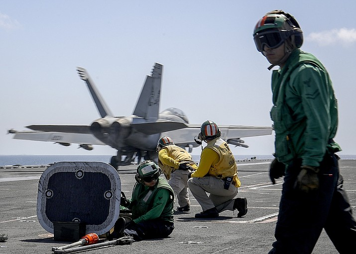 """In this Monday, May 20, 2019 photo, released by U.S. Navy, an F/A-18E Super Hornet from the """"Jolly Rogers"""" of Strike Fighter Squadron (VFA) 103 launches from the flight deck of the Nimitz-class aircraft carrier USS Abraham Lincoln (CVN 72) on Arabian Sea. (Mass Communication Specialist 3rd Class Jeff Sherman/U.S. Navy via AP)"""