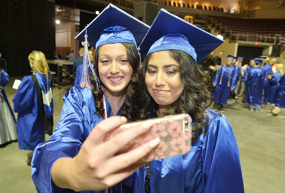 Olivia Robertson and Xadani Millan take a selfie before Chino Valley HIgh School graduated 153 students in a commencement ceremony Wednesday, May 22 at the Findlay Toyota Center in Prescott Valley. (Les Stukenberg/Courier)