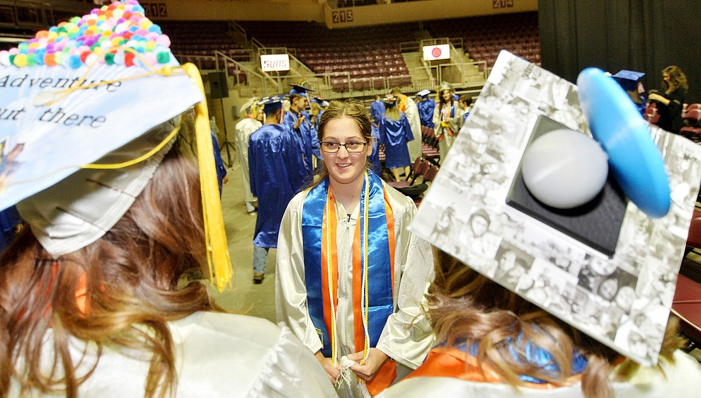 Abbie Golden talks with friends before Chino Valley HIgh School graduated 153 students in a commencement ceremony Wednesday, May 22 at the Findlay Toyota Center in Prescott Valley. (Les Stukenberg/Courier)