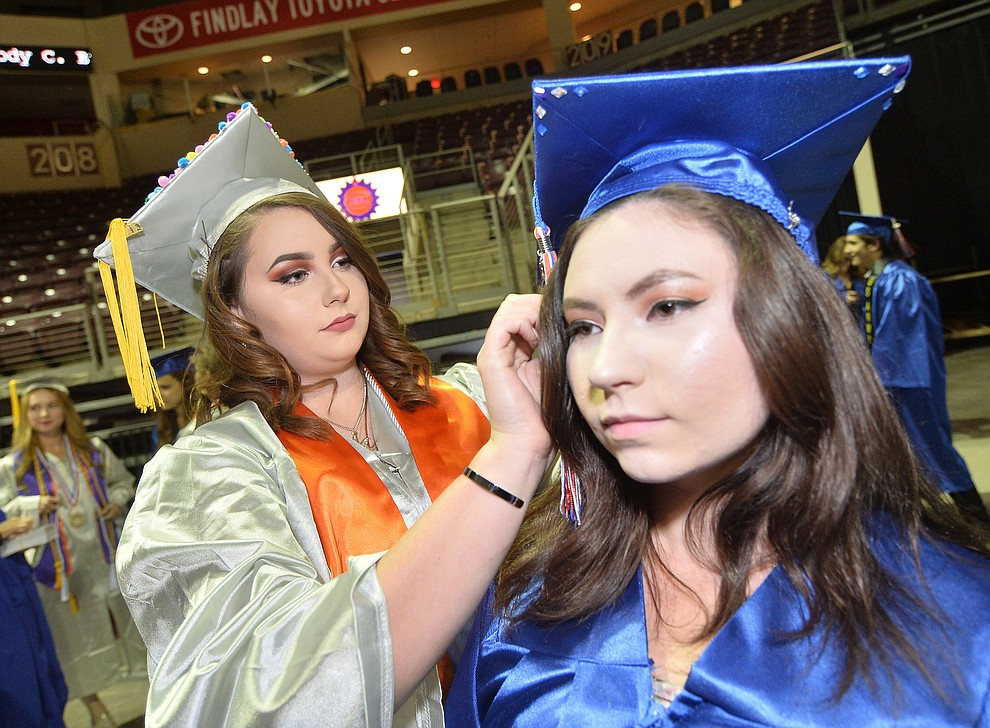 Madisen Scott adjusts Michaela Scott's mortar board before Chino Valley HIgh School graduated 153 students in a commencement ceremony Wednesday, May 22 at the Findlay Toyota Center in Prescott Valley. (Les Stukenberg/Courier)