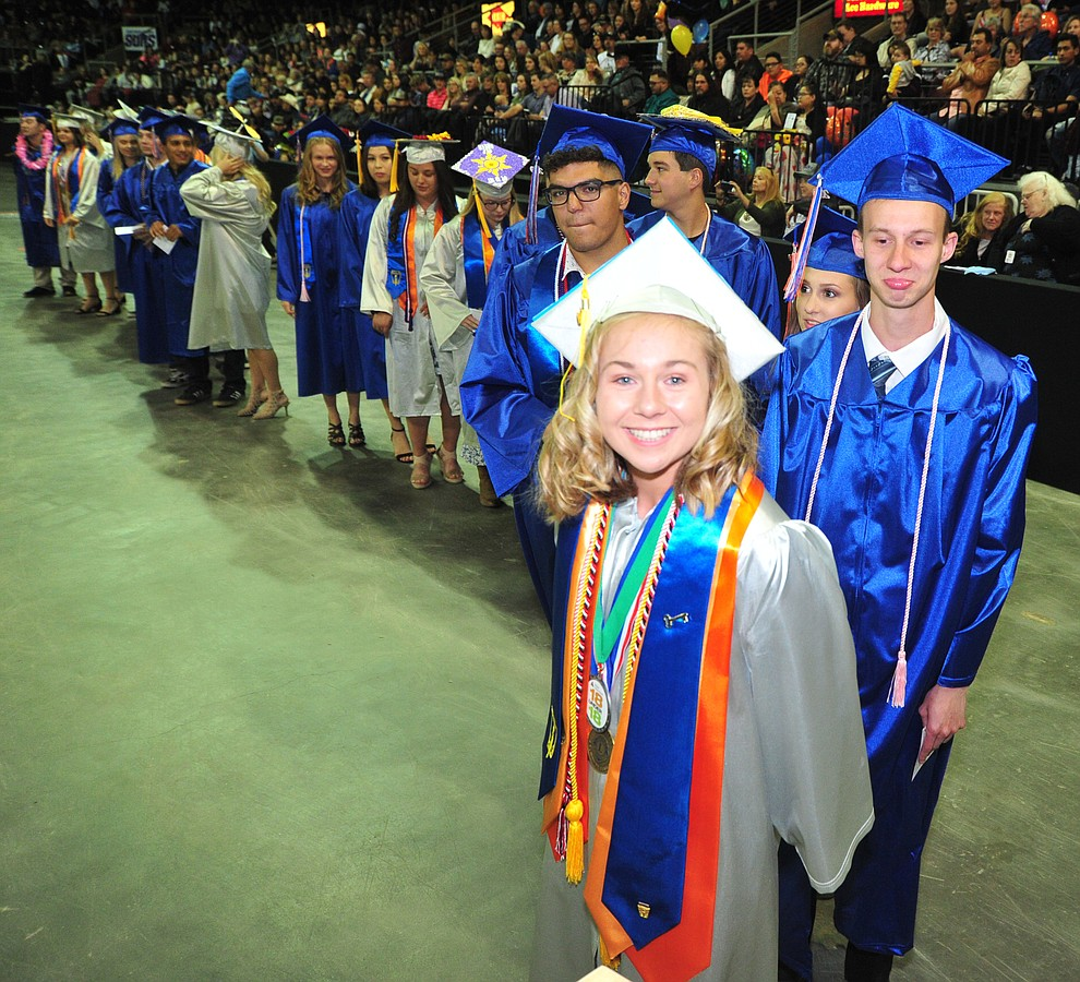 Addie Daniels and other students wait for their diplomas as Chino Valley HIgh School graduated 153 students in a commencement ceremony Wednesday, May 22 at the Findlay Toyota Center in Prescott Valley.  (Les Stukenberg/Courier)