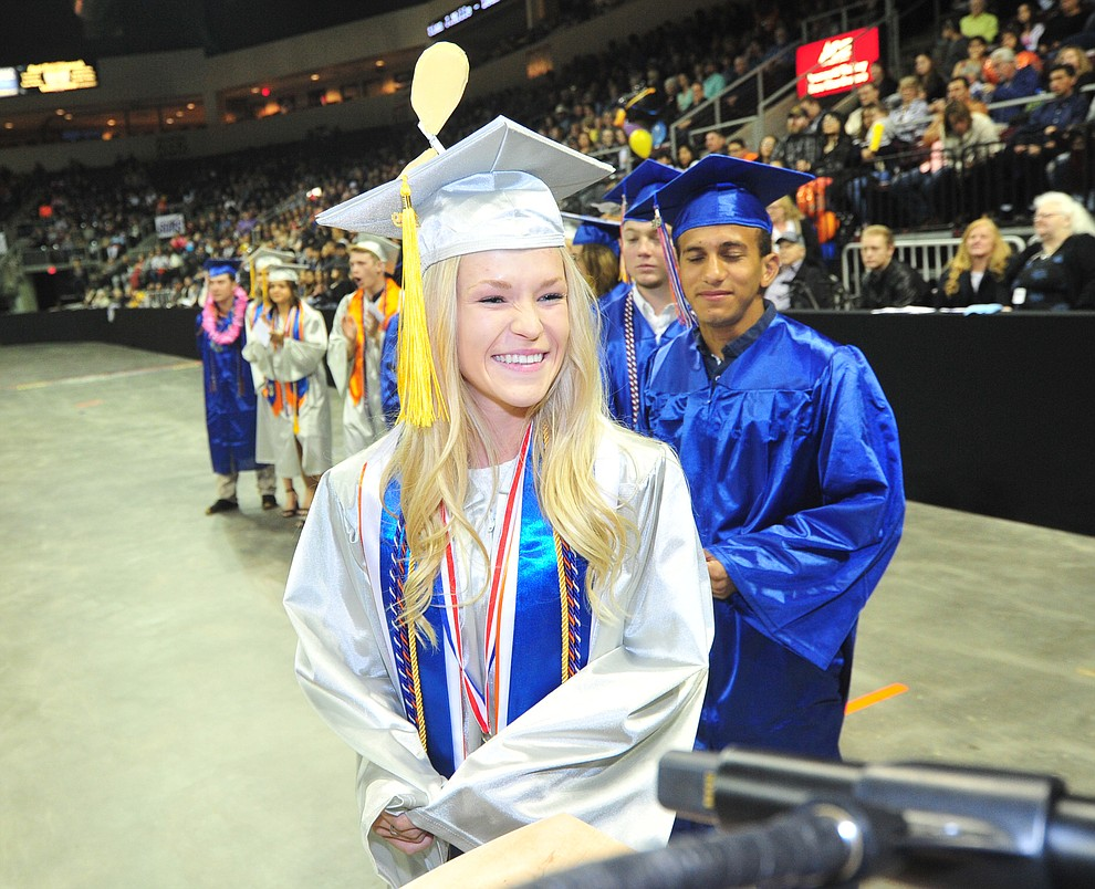 Lauren Foster is all smiles as Chino Valley HIgh School graduated 153 students in a commencement ceremony Wednesday, May 22 at the Findlay Toyota Center in Prescott Valley.  (Les Stukenberg/Courier)