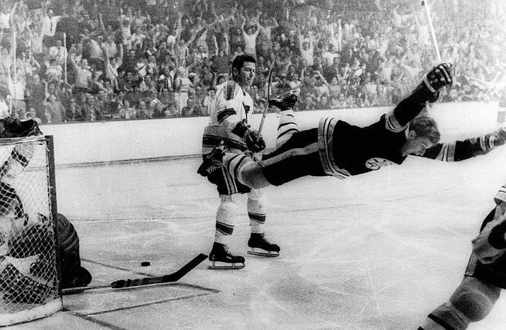In this May 10, 1970, file photo, Boston Bruins' Bobby Orr goes into the air after scoring a goal against the St. Louis Blues that won the Stanley Cup for the Bruins, in Boston. Orr and the big, bad Boston Bruins swept the expansion-era Blues in that series. Now 49 years later, Boston is in its third final in nine seasons and St. Louis is back for the first time since 1970 (Ray Lussier/The Boston Herald via AP, File)