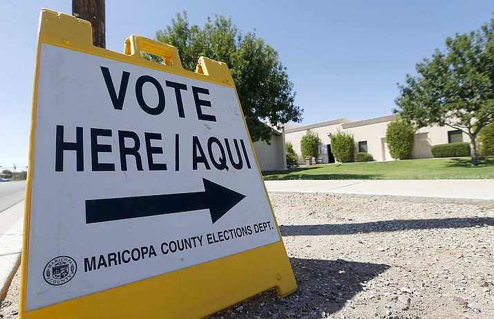 A voting sign directs voters to a precinct on primary election day Tuesday, Aug. 28, 2018, in Phoenix. (Ross D. Franklin/AP, file)
