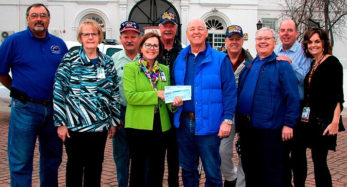 Disabled Veterans Benefit Raffle presents $12,200 check in 2018 to the Department of Veterans Affairs Medical Center in Prescott. Courtesy photo