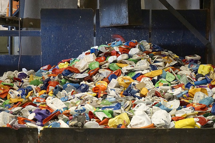 Plastic materials are sorted from a residential recycling stream at a material recovery facility in Austin, Texas. Recycling systems are facing challenges in many places, but some experts say it's still growing. (Institute of Scrap Recycling Industries via AP)