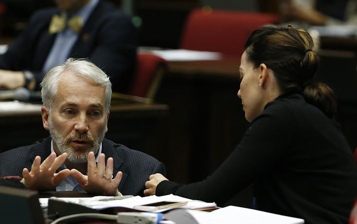 Arizona legislators Randall Friese, left, and Michelle Ugenti-Rita, right. (Ross D. Franklin/AP, file)