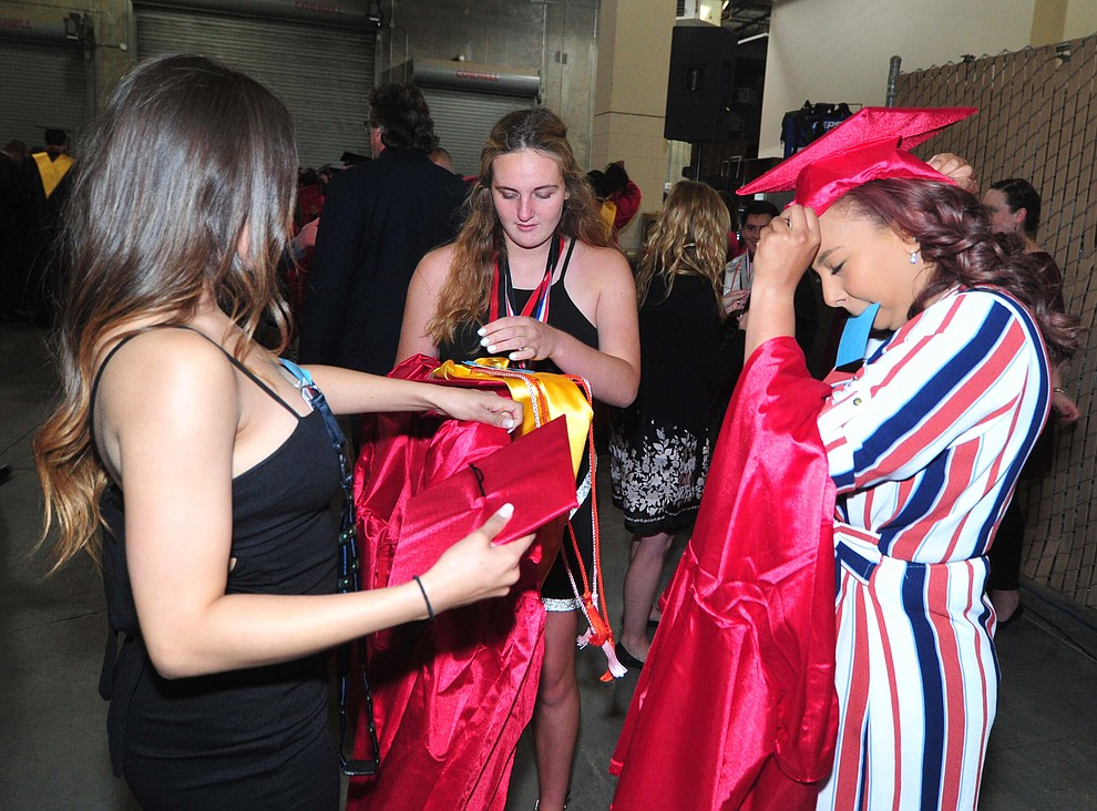 Bianca Lujan, Madlen Dodova and Alexis Lara get ready as Bradshaw Mountain High School graduated 334 students in a commencement ceremony Thursday, May 23 at the Findlay Toyota Center in Prescott Valley. (Les Stukenberg/Courier)