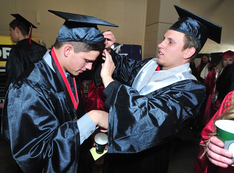 Luke Huenemeyer helps Parker Hines before Bradshaw Mountain High School graduated 334 students in a commencement ceremony Thursday, May 23 at the Findlay Toyota Center in Prescott Valley. (Les Stukenberg/Courier)